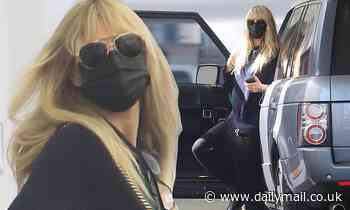 Heidi Klum stays safe in style as she runs errands wearing her face mask and Gucci purse