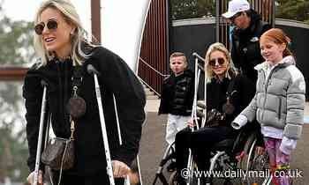 Pictures confirm Roxy Jacenko's injury: Star hobbles around in crutches weeks before SAS Australia