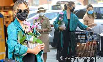 Chrissy Teigen picks up some groceries following her baby loss