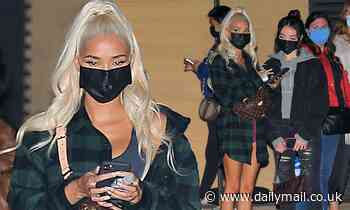 Pia Mia keeps it casual in a crop top and oversize flannel shirt as she heads for dinner at Nobu