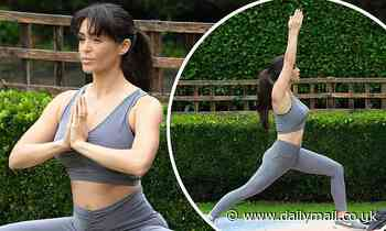 Casey Batchelor dons flesh-flashing exercise gear while showcasing her expert yoga moves