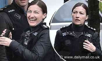 Line Of Duty: Kelly Macdonald shares a joke with co-stars as she films on location in Belfast