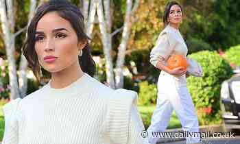 Olivia Culpo serves fall vibes as the model stocks up for Halloween at a pumpkin patch in Encino