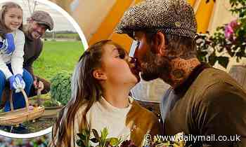 David Beckham gives daughter Harper, 9, a kiss as they forage for fruit and vegetables
