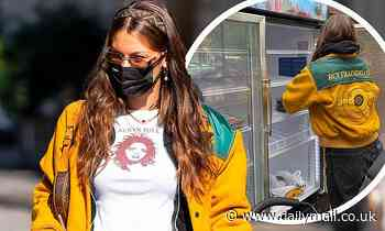 Bella Hadid dons Varsity jacket and baggy jean while donating groceries to NYC community fridge
