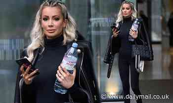 Olivia Attwood looks chic in an all-black ensemble as she steps out in Manchester