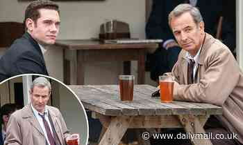 Grantchester's Tom Brittney and Robson Green enjoy a pint as they film pub scene for series six