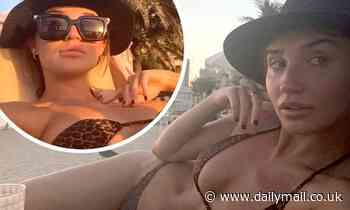 Megan McKenna flaunts her toned physique in a leopard print bikini in Dubai