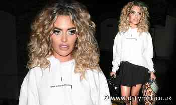 Megan Barton Hanson channels the disco era with blonde corkscrew curls as she leaves photoshoot