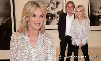 Anthea Turner exudes style in a silk shirt as she steps out with fiancé after supporting John Leslie