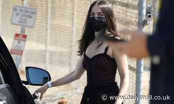 Ana de Armas rocks a black and red polka dot dress with a matching face mask