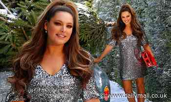 Kelly Brook looks radiant in a silver shimmering mini dress as she poses in festive photoshoot