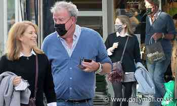 Jeremy Clarkson shares a laugh with a female pal at a posh organic grocers in London