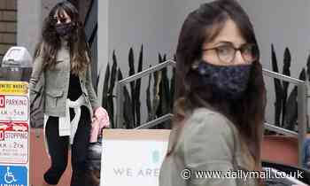 Jordana Brewster gets into the Halloween spirit with a black spider web print mask in Brentwood