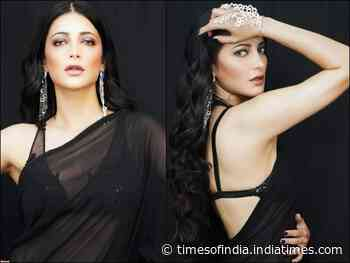 Hotness Alert! Shruti Haasan looks irresistible in a black saree and bikini blouse