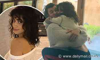 Camila Cabello wraps her legs around Shawn Mendes... after showing off new short hair