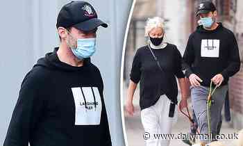 Hugh Jackman and his wife Deborra-lee Furness wear face masks in NYC