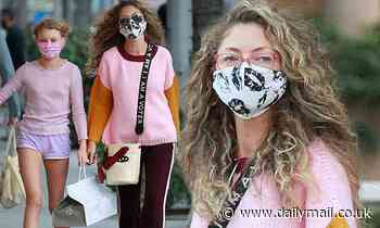 Rebecca Gayheart rocks an 'I Am A Voter' purse while picking up sushi with daughter Beatrice in LA