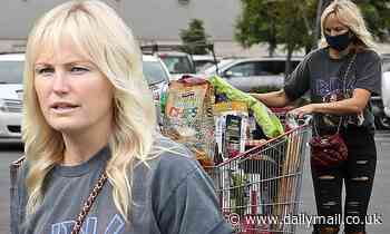 Malin Akerman is casually stylish in graphic tee and ripped jeans as she stocks up on supplies in LA