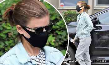 Kate Mara keeps casual in a light denim jacket and a pair of grey sweatpants as she runs errands
