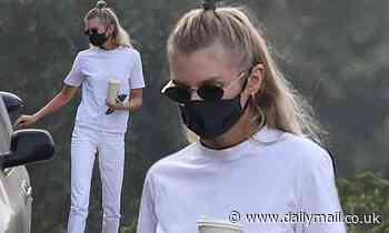 Stella Maxwell looks effortlessly cool in an all white ensemble as she grabs coffee in Los Angeles