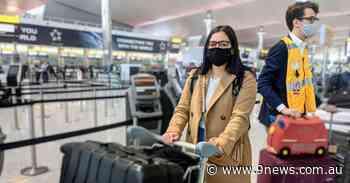 First repatriation flight brings stranded Australians home as international flight caps edge up again - 9News