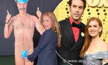 Isla Fisher poses next to a cardboard cut-out of Borat