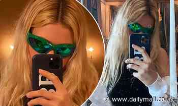 Nicola Peltz flashes her 'BB' Brooklyn Beckham phone case as they 'DELAY their wedding until 2022'