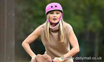 Caprice, 48, puts safety first as she dons funky pink helmet