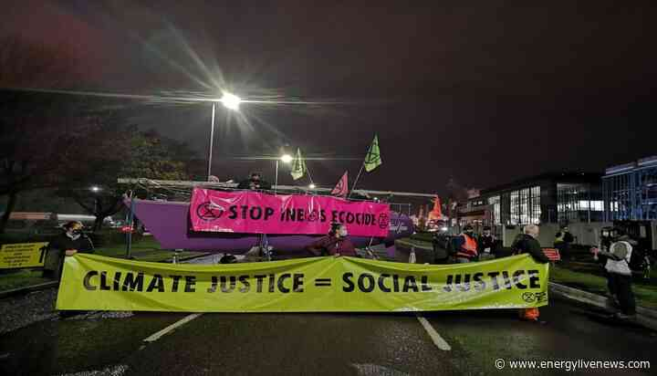 Extinction Rebellion activists lock themselves at the gates of INEOS refinery