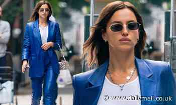 Irina Shayk puts on a stylish display in a blue leather suit and sheer white top