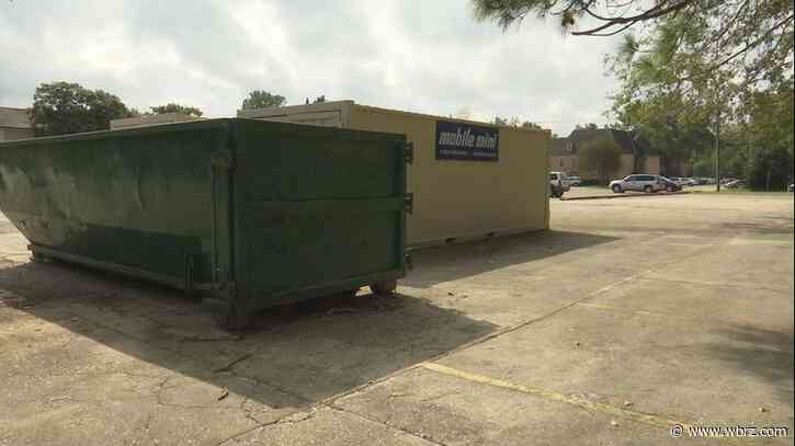 Dumpsters full of trash finally removed from neighboring apartment complex