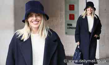 Mollie King nails autumnal style in a wrap coat and a bucket hat