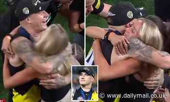 AFL superstar Dustin Martin, 29, celebrates with a blonde friend after winning the Grand Final