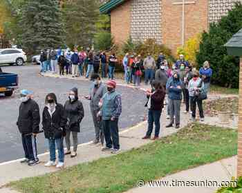 Voters flood to polls find long waits, 'nightmare' traffic, even applause