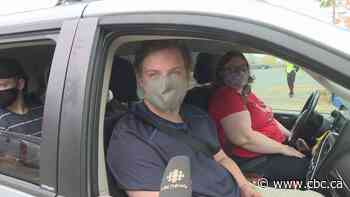 Hundreds roll through Nova Scotia drive-thru flu shot clinic