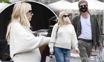 Emma Roberts drapes her baby bump in a cream sweater while out in LA with beau Garrett Hedlund