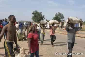Looters raid Nigeria food warehouse as unrest spreads