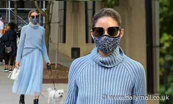 Olivia Palermo oozes elegance as she strolls with her dog Mr Butler in NYC