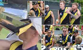 Richmond Tigers AFL players celebrate their third premiership in four years