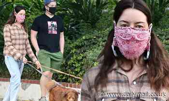 Aubrey Plaza enjoys the company of a friend during her daily walk with her two rescue dogs in LA