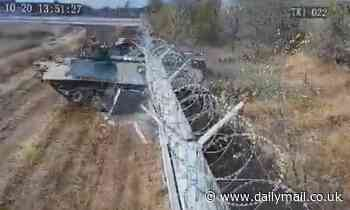 'Drunk' Russian soldiers crush tank through metal fence at Volgograd Airport - Daily Mail