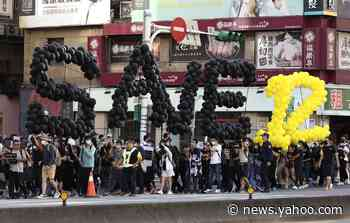 Hundreds march in Taiwan to support 12 arrested Hong Kongers