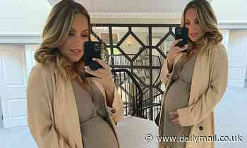 Pregnant Kate Ferdinand displays her blossoming baby bump
