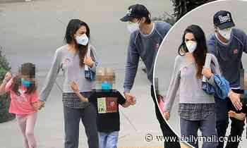 Ashton Kutcher and Mila Kunis proudly display their 'I Voted' stickers as they vote in LA