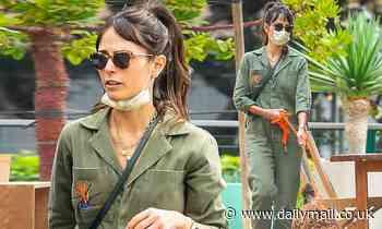 Jordana Brewster looks fabulous in green jumpsuit as she walks her fluffy pup in Malibu