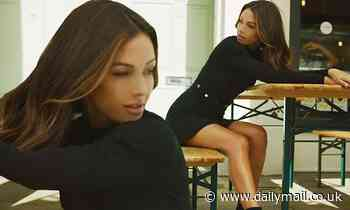 Michelle Keegan showcases her sensational figure as she strikes a pose in a black mini dress