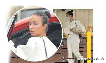 Draya Michele covers up her curves in baggy sweatsuit as she shops for a pumpkin in West Hollywood