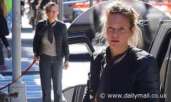 Uma Thurman keeps warm in puffy blue jacket and beige sweater as she walks her dog in NYC