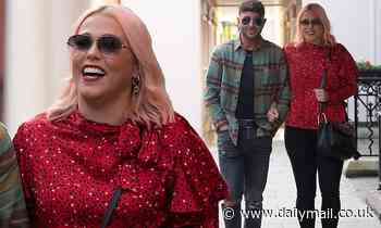 Amelia Lily looks radiant in a red frill blouse